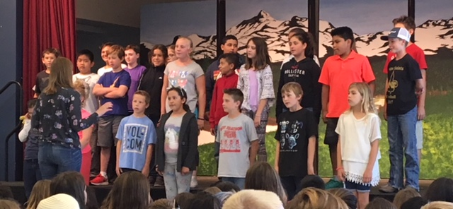 elementary student group singing