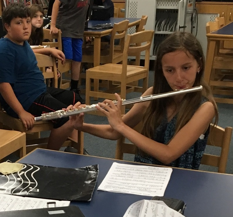 student playing flute