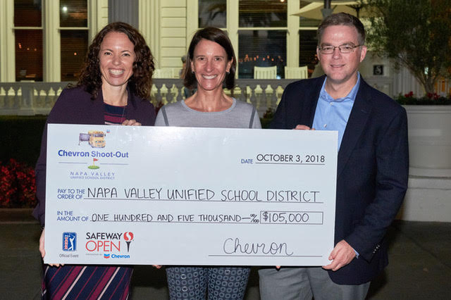 NVUSD Superintendent Dr. Rosanna Mucetti,  l , and Napa County Supervisor Ryan Gregory  accept a check for  105,000 from Chevron representative Julie Wirth during the Safeway Open earlier this month.