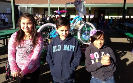 READING FOR BIKES - Three happy students, Jennifer, Carlos and Arizabeth, are winners of new bikes thanks to turning in 100% of their reading logs this trimester. Other winners received backpacks and ice cream gift certificates in this random drawing of 100% readers at Shearer Elementary School.
